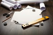 foto of mechanical drawing  - Tools and papers with sketches on the table - JPG