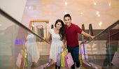 image of escalator  - Young asian couple on the escalator in shop mall - JPG