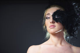 pic of azazel  - portrait of sexy woman with black feather half mask for Venice desire concept - JPG