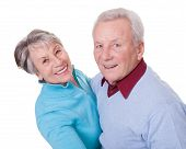 stock photo of waltzing  - Portrait Of Senior Couple Dancing On White Background - JPG