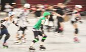 foto of roller-derby  - some women participating in roller derby with a motion blur - JPG