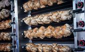 foto of spit-roast  - roasting chicken at a market in spain - JPG