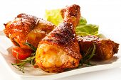 stock photo of poultry  - Roasted chicken drumsticks - JPG