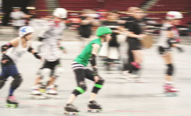 stock photo of roller-derby  - some women participating in roller derby with a motion blur - JPG