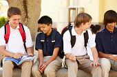 foto of playground school  - Male High School Students Hanging Out On School Campus - JPG