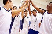 stock photo of motivation talk  - Male High School Basketball Team Having Team Talk With Coach - JPG