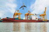 stock photo of ship  - Container Cargo freight ship and plane with working crane bridge in shipyard for Logistic Import Export background - JPG
