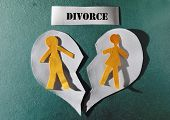 stock photo of divorce-papers  - Paper couple and heart split apart  - JPG