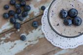 stock photo of vanilla  - Banana and Blueberry smoothie summer breakfast with vanilla sticks - JPG