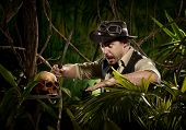 foto of machete  - Explorer with machete in the jungle discovering a human skull - JPG