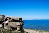 picture of stonewalled  - Blue water view with a stonewall - JPG