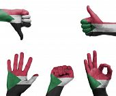 foto of sudan  - A set of hands with different gestures wrapped in the flag of Sudan - JPG