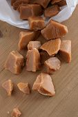 image of toffee  - Toffee pieces in a paper sweet bag - JPG