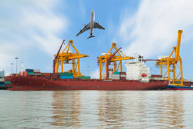 stock photo of shipyard  - Container Cargo freight ship and plane with working crane bridge in shipyard for Logistic Import Export background - JPG