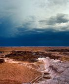 stock photo of thunderhead  - Storm clouds forming in the painted desert northeastern Arizona - JPG