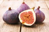 picture of exotic_food  - Fresh figs on rustic vintage wooden table - JPG