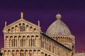 stock photo of piazza  - Sunset over Piazza dei Miracoli in Pisa Italy - JPG
