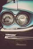 stock photo of headlight  - Color detail on the headlight of a vintage car - JPG