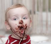 picture of messy  - chocolate on face of funny cute boy messy eater