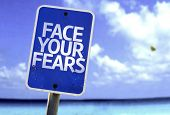 image of persistence  - Face Your Fears sign with a beach on background - JPG