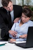 stock photo of inappropriate  - Young pretty woman and prolem with inappropriate boss - JPG