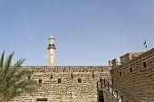 foto of dubai  - Historical Dubai Museum in Dubai with the minaret of the Grand Mosque in the background United Arab Emirates - JPG
