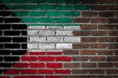 stock photo of kuwait  - Very old dark red brick wall texture with flag  - JPG