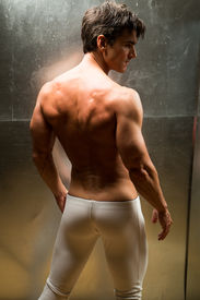stock photo of paranormal  - the hot laird stands with back to the camera - JPG