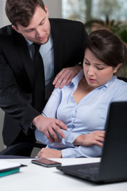 image of inappropriate  - Young pretty woman and prolem with inappropriate boss - JPG