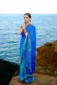 picture of indian sari  - Beautiful girl in traditional Indian sari on temple background - JPG