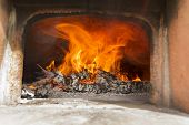 stock photo of oven  - Preparation and heating of the oven for cooking food - JPG