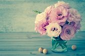 foto of vase flowers  - Gentle Flowers in a glass vase with copy space  - JPG