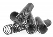 picture of amortization  - Pile of steel springs on white background - JPG