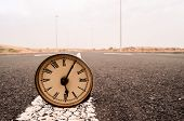 picture of time-bomb  - Time Concept Alarm Clock on the Asphalt Street - JPG
