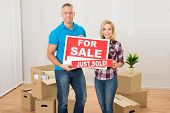 Постер, плакат: Couple Holding Sold Sign