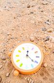 image of analog clock  - Classic Analog Clock In The Sand On The Rock Desert - JPG
