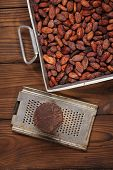 stock photo of cocoa beans  - roasted cocoa beans in Vintage heavy cast aluminum roasting pan and and 100 - JPG
