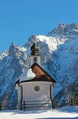 stock photo of piety  - idyllic chapel in wintry landscape near mittenwald germany