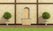 foto of pilaster  - Classic garden with nichestone wall and wooden floor  - JPG