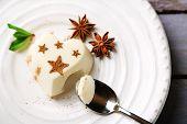 stock photo of panna  - Tasty panna cotta dessert on plate - JPG
