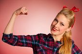 picture of pinup girl  - Beautiful young blond Pinup woman gesturing we can do it over red background - JPG