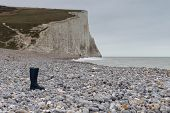 picture of shingles  - A lone wellington boot on a beach of shingle - JPG