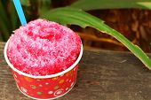 stock photo of ice-cream truck  - Red water Shaved ice on the wood table - JPG