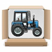 picture of truck farm  - Toy tractor in open carton box isolated on white background - JPG
