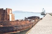 image of wrecking  - Rusty wreck moored abandoned in the pier in the harbor of Cagliari Sardinia - JPG