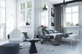 stock photo of ottoman  - Large spacious modern bedroom interior with grey and white decor - JPG