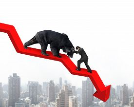stock photo of stop fighting  - Businessman against black bear on red arrow downward trend line with sky cityscape background - JPG