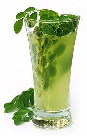 image of malunggay  - Ayurvedic Juice made from moringa leaves over white background - JPG