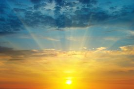 stock photo of cloudy  - A beautiful sun rise and cloudy sky - JPG