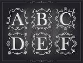 stock photo of letter d  - Blackboard chalk vintage calligraphic letters in monogram retro frames - JPG